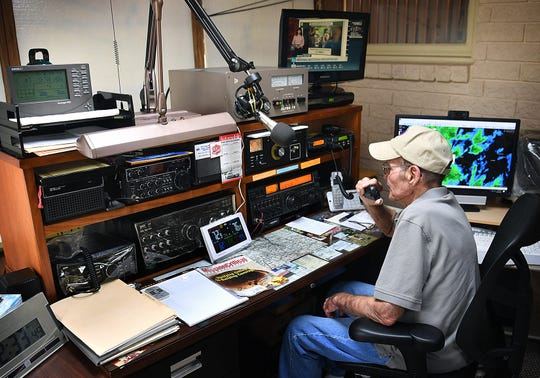 Ham radio operator Charlie Byars mans his equipment which allows him to communicate with a network of weather spotters throughout North Texas and other amateur radio enthusiasts around the world.