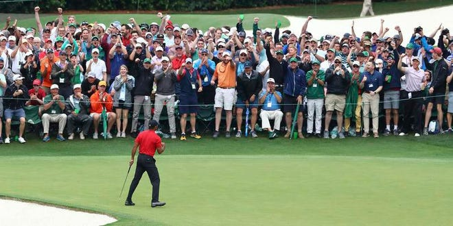 Tiger Woods celebrates his fifth Masters win on Sunday.
