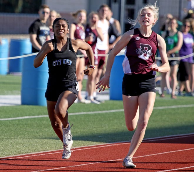 City View's Onjolyce Navarro and Bowie's Jayci Logan compete in the 100 meter dash Monday, April 15, 2019, in the Area 7/8-3A Track and Field Championship in Jacksboro.