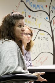 Muskingum County Adult and Child Protective Services caseworkers Jennifer Ball, left, and Nichole Flowers talk about the need for more foster parents at the MCACP offices in Zanesville.