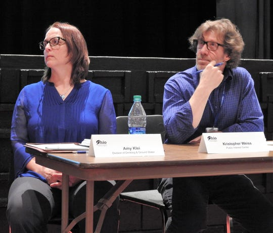 Amy Klei and Kristopher Weiss of the Ohio Environmental Protection Agency listen to testimony at Coshocton High School during a second hearing regarding reclassifying injection wells at Buckeye Brine from Class II to Class I.
