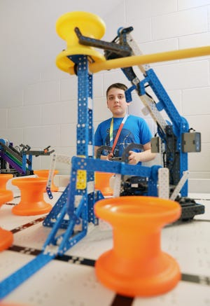Driver Karter Bludnick runs the John McIntire Elementary School robot through it's paces in preparation for a trip to the VEX Robotics World Championships later this month.