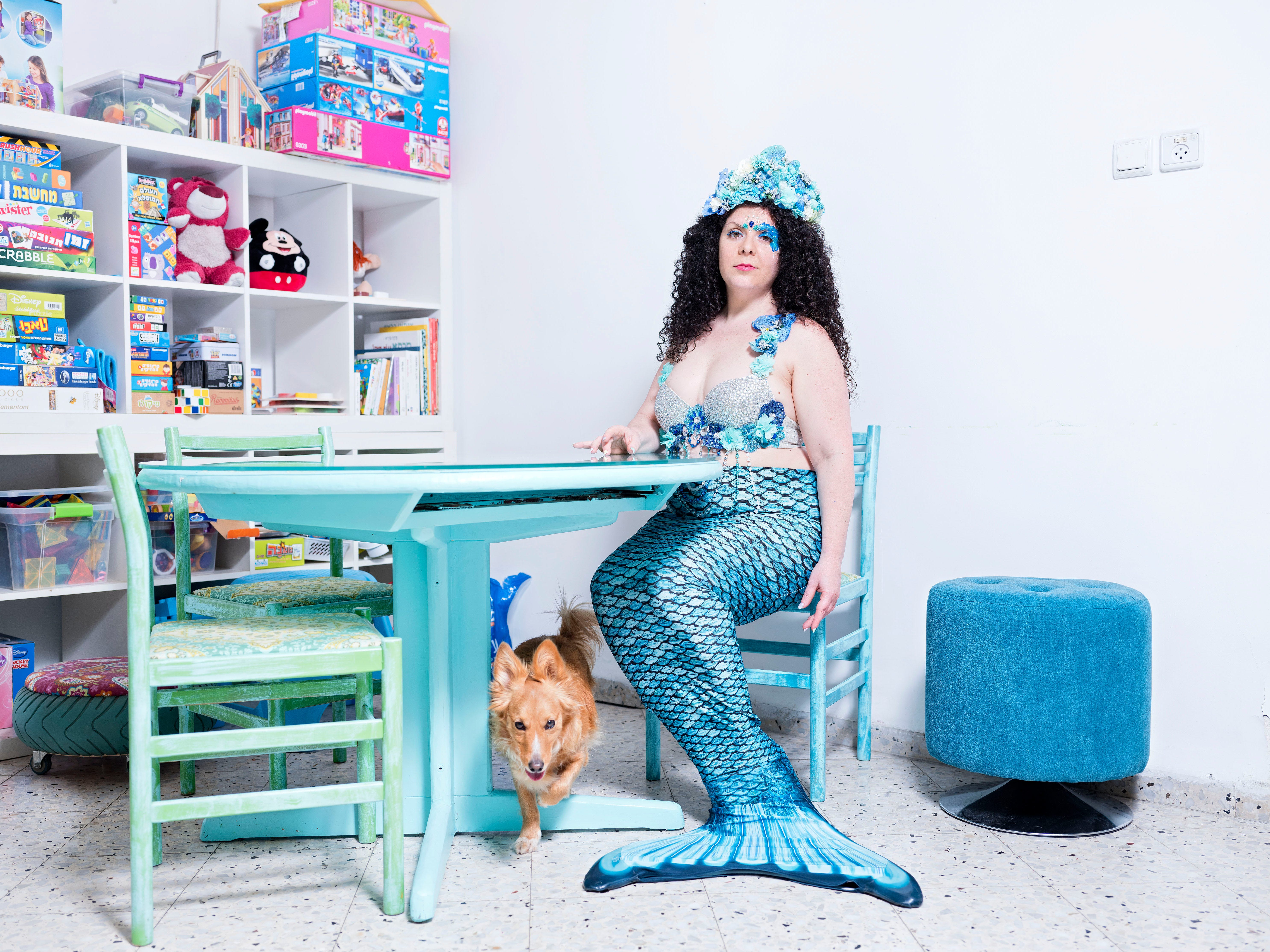 In this Monday, March. 4, 2019 photo, Inbar Ben Yakar, a member of the Israeli Mermaid Community, poses for a portrait as she wears a mermaid tail at her home in Kiryat Yam, Israel.