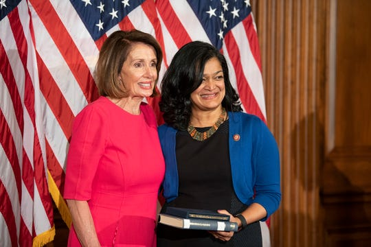 Rep. Pramila Jayapal, D-WA, is sworn in by House Speaker Nancy Pelosi as a member of the 116th Congress on Jan. 3, 2019.