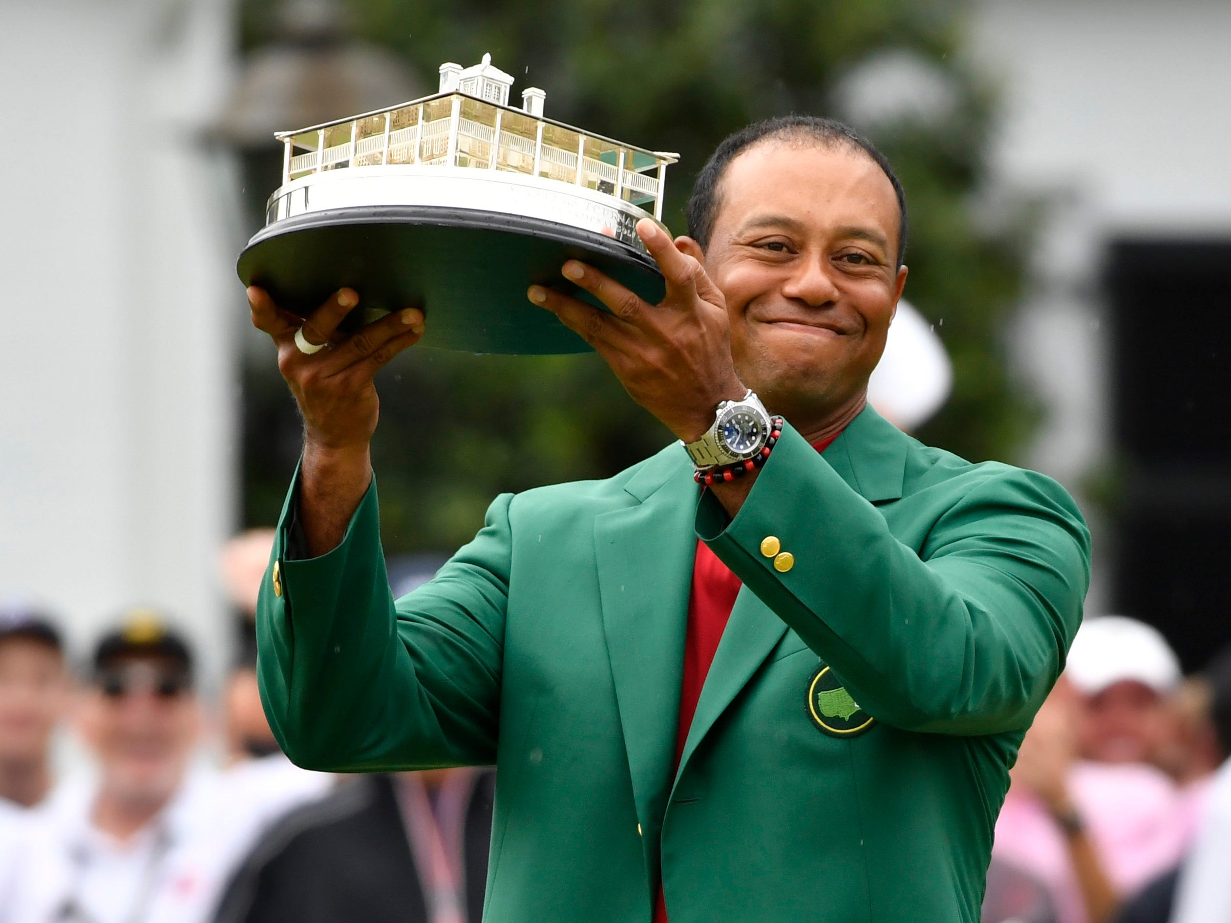 April 14: Tiger Woods celebrates with the green jacket and trophy after winning the Masters at Augusta National Golf Club.