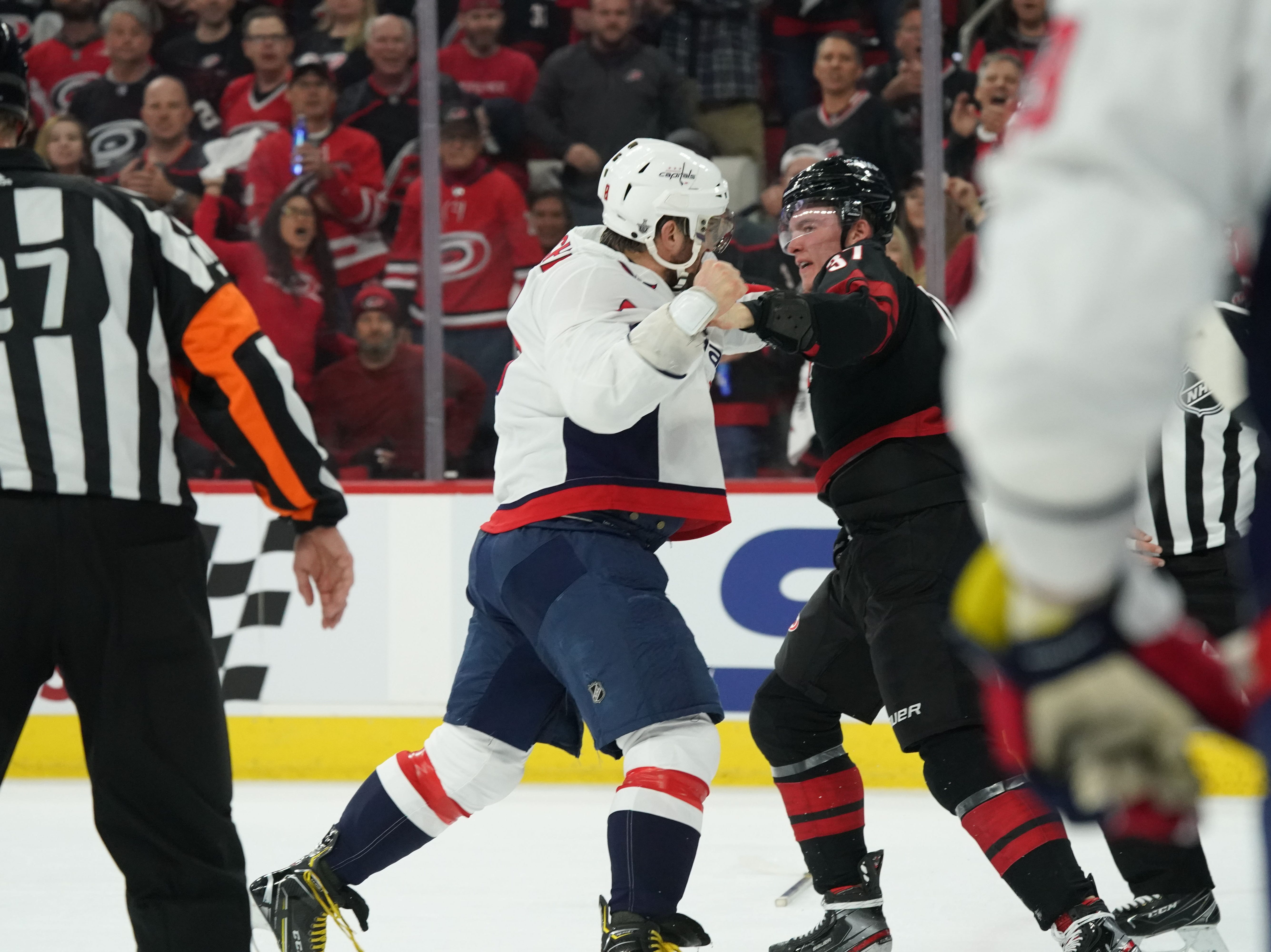 First round: Washington Capitals forward Alex Ovechkin (8) fights Carolina Hurricanes forward Andrei Svechnikov (37) during the first period of Game 3.