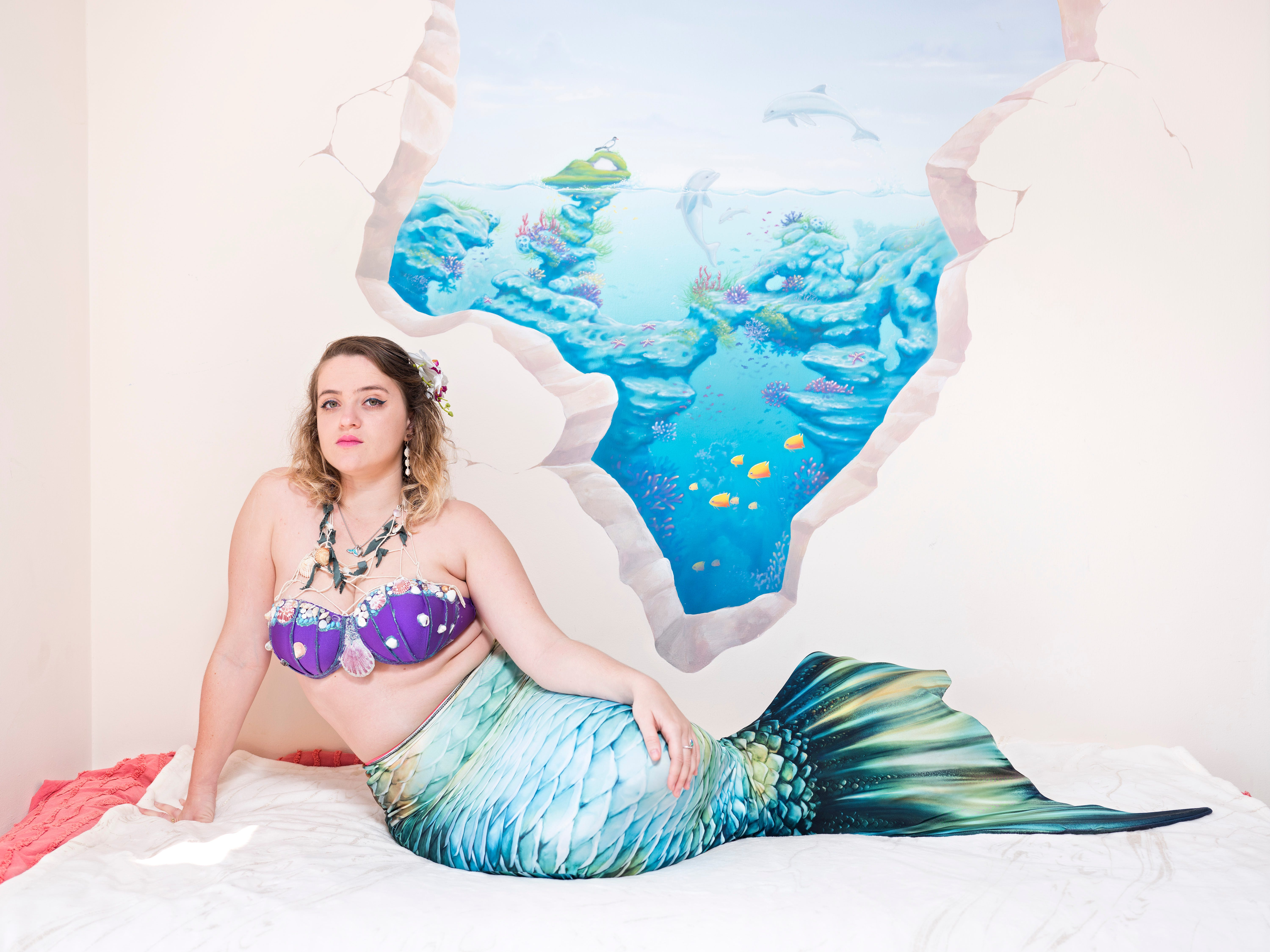 In this Wednesday, March. 6, 2019 photo, Michelle Koretsky, a member of the Israeli Mermaid Community, poses for a portrait as she wears a mermaid tail at her home in Ra'anana, Israel.