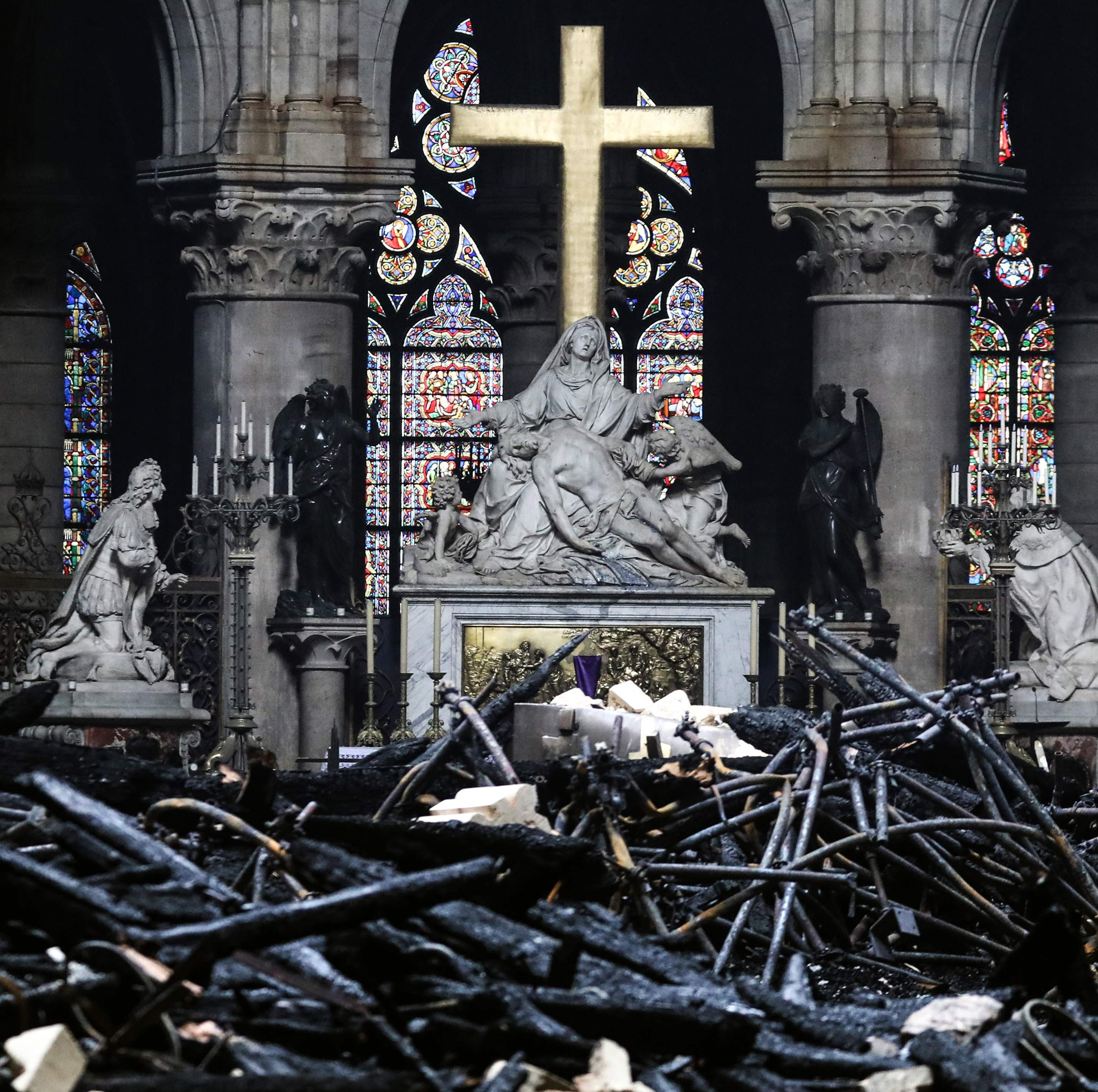 The main altar in Notre Dame Cathedral surrounded by charred debris on April 16, 2019. A white marble Pieta seems to have survived a devastating fire on April 15.
