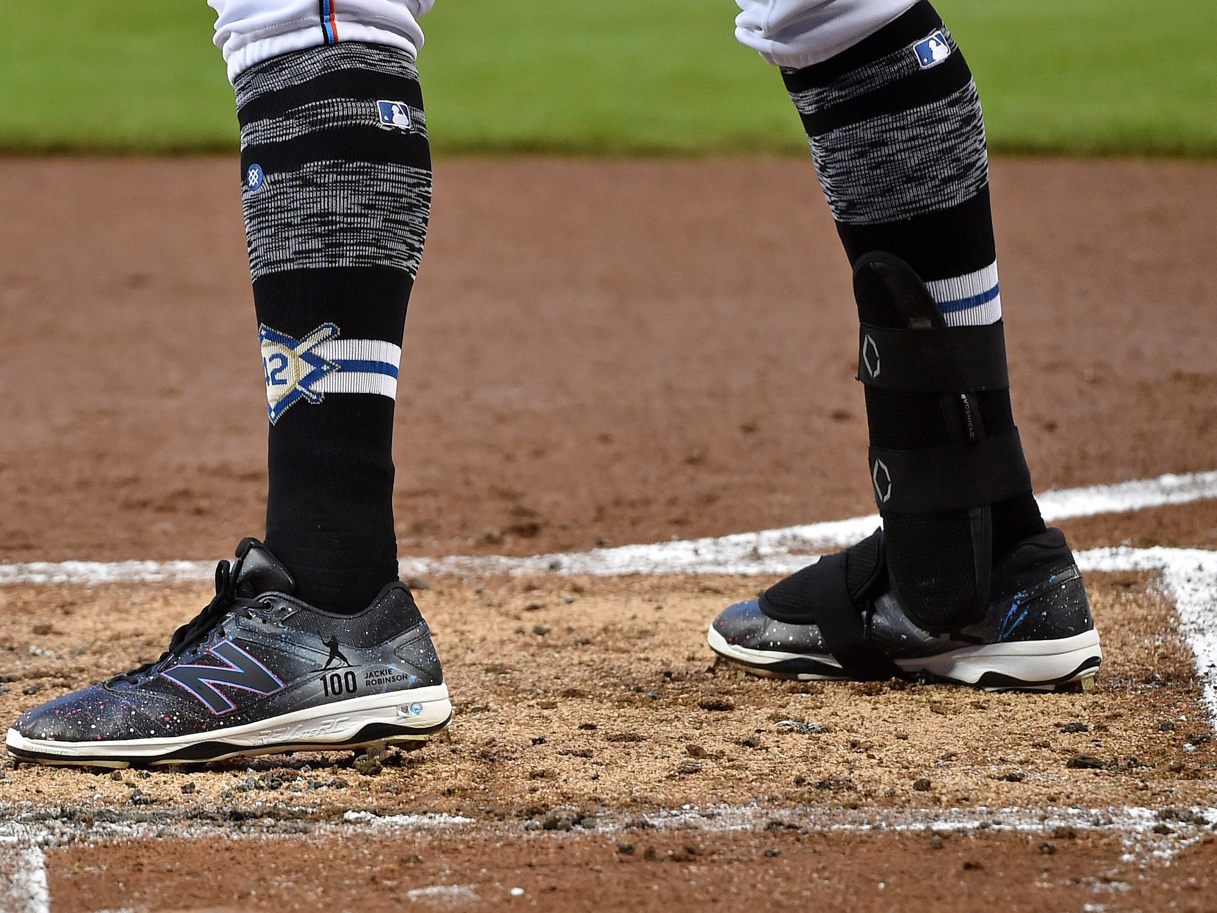 Marlins left fielder Curtis Granderson steps into the batters box wearing the No. 42 on his socks in honor of Jackie Robinson.
