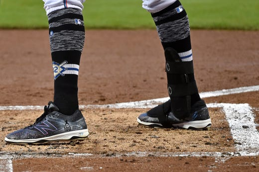 Marlins left fielder Curtis Granderson steps into the batters box wearing the No. 42 on his socks in honor of Jackie Robinson. - Rays Pitcher Breaks Toe In Freak Accident