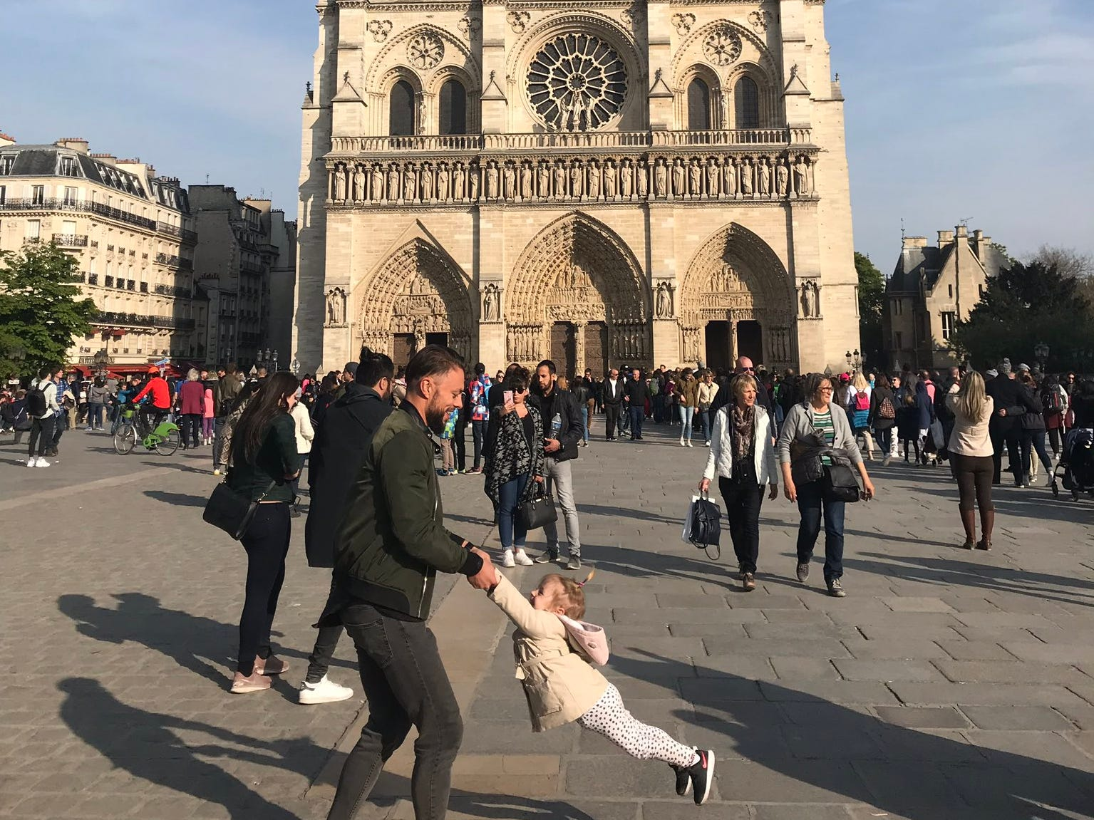 Do you know who's in this photo taken hour before Notre Dame Cathedral fire?