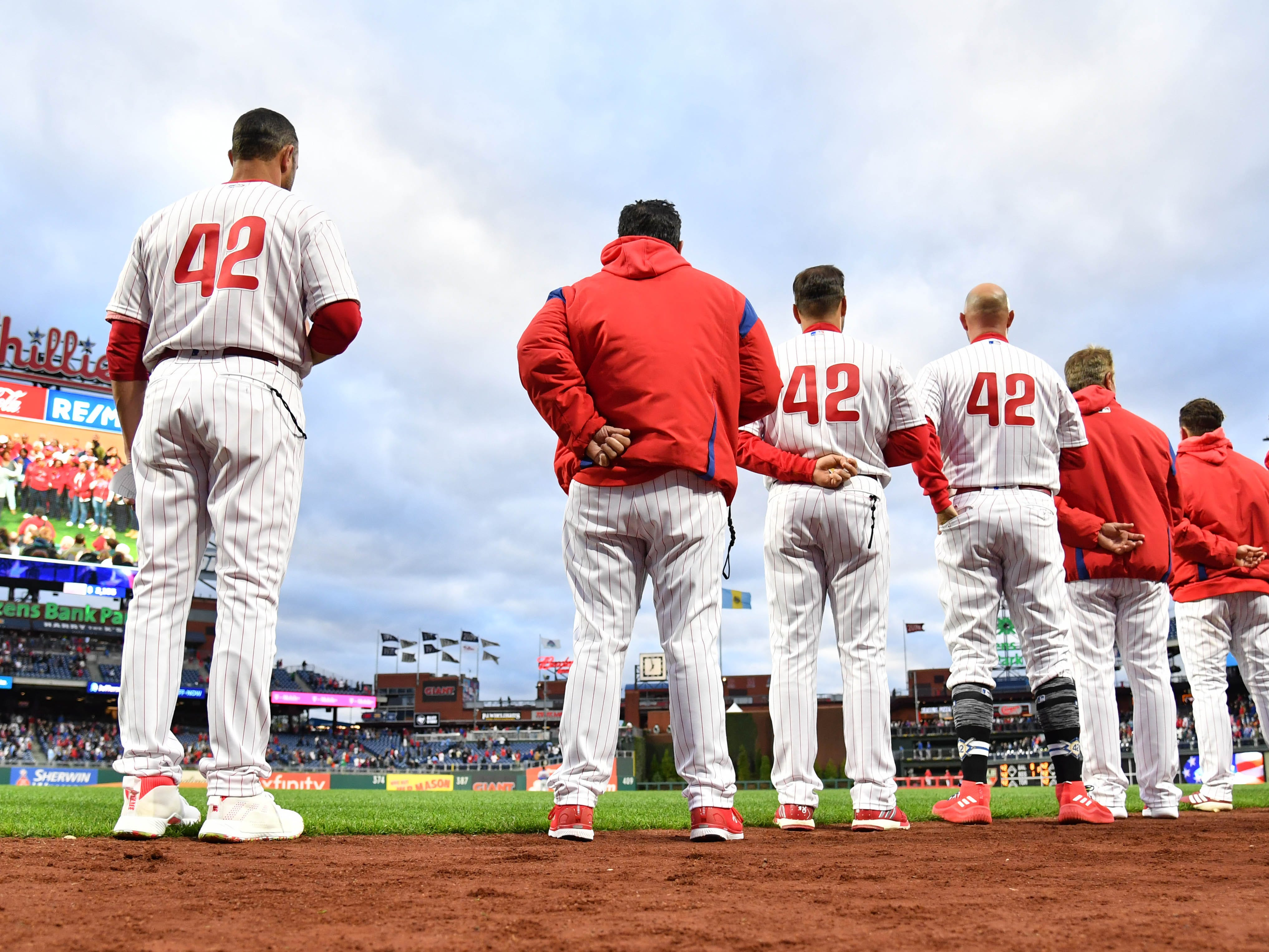 The Phillies line up for the national anthem with the No. 42 on their jersey for Jackie Robinson.
