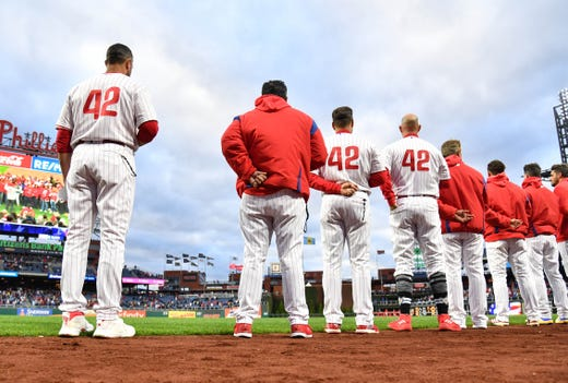The Phillies line up for the national anthem with the No. 42 on their jersey for Jackie Robinson. - Rays Pitcher Breaks Toe In Freak Accident