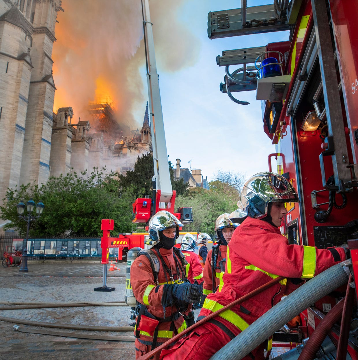 This photo provided by the Paris Fire Brigade, shows fire fighters working at the burning Notre Dame cathedral, on April 15. Experts assessed the blackened shell of Paris' iconic Notre Dame Tuesday morning to establish next steps to save what remains after a devastating fire destroyed much of the cathedral that had survived almost 900 years of history.