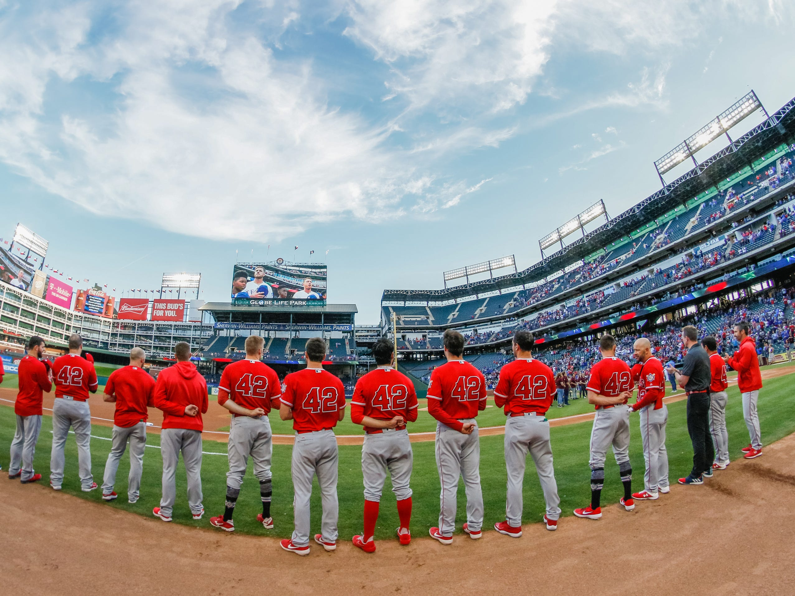 The Angels players stand along the third base line during the national anthem all wearing the No. 42 for Jackie Robinson.