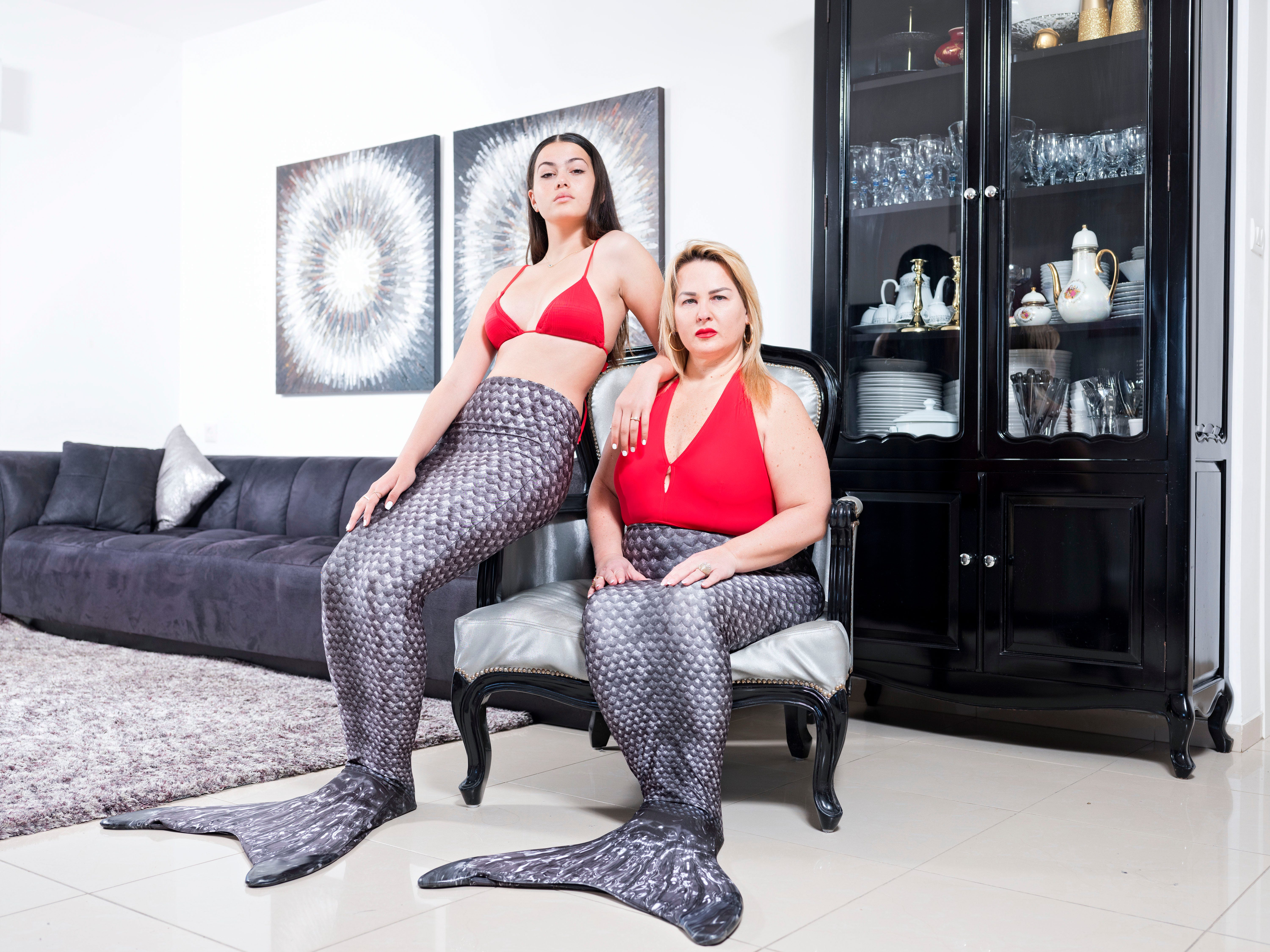 In this Wednesday, March. 6, 2019 photo, Limor Kahlon, right, and her daughter Yam, members of the Israeli Mermaid Community, pose for a portrait as they wear mermaid tails at their home in Netanya, Israel.