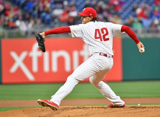 Phillies starting pitcher Aaron Nola, wearing No. 42, throws a pitch. - Rays Pitcher Breaks Toe In Freak Accident
