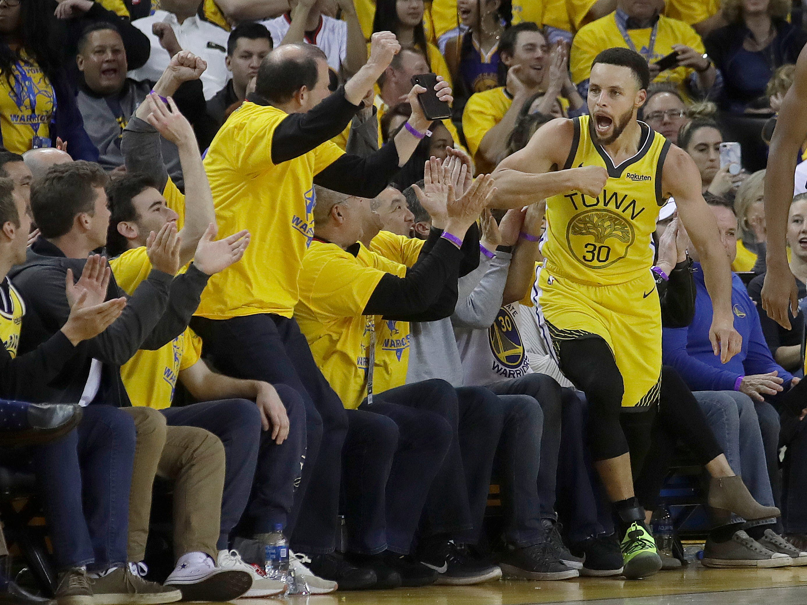 April 15: Warriors guard Stephen Curry celebrates after scoring against the Clippers during the first half of Game 2.