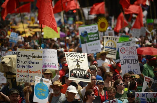 People march from the U.S. Capitol to the White House for the People's Climate Movement to protest President Donald Trump's environmental policies April 29, 2017 in Washington, DC. Demonstrators across the country are gathering to demand  a clean energy economy.