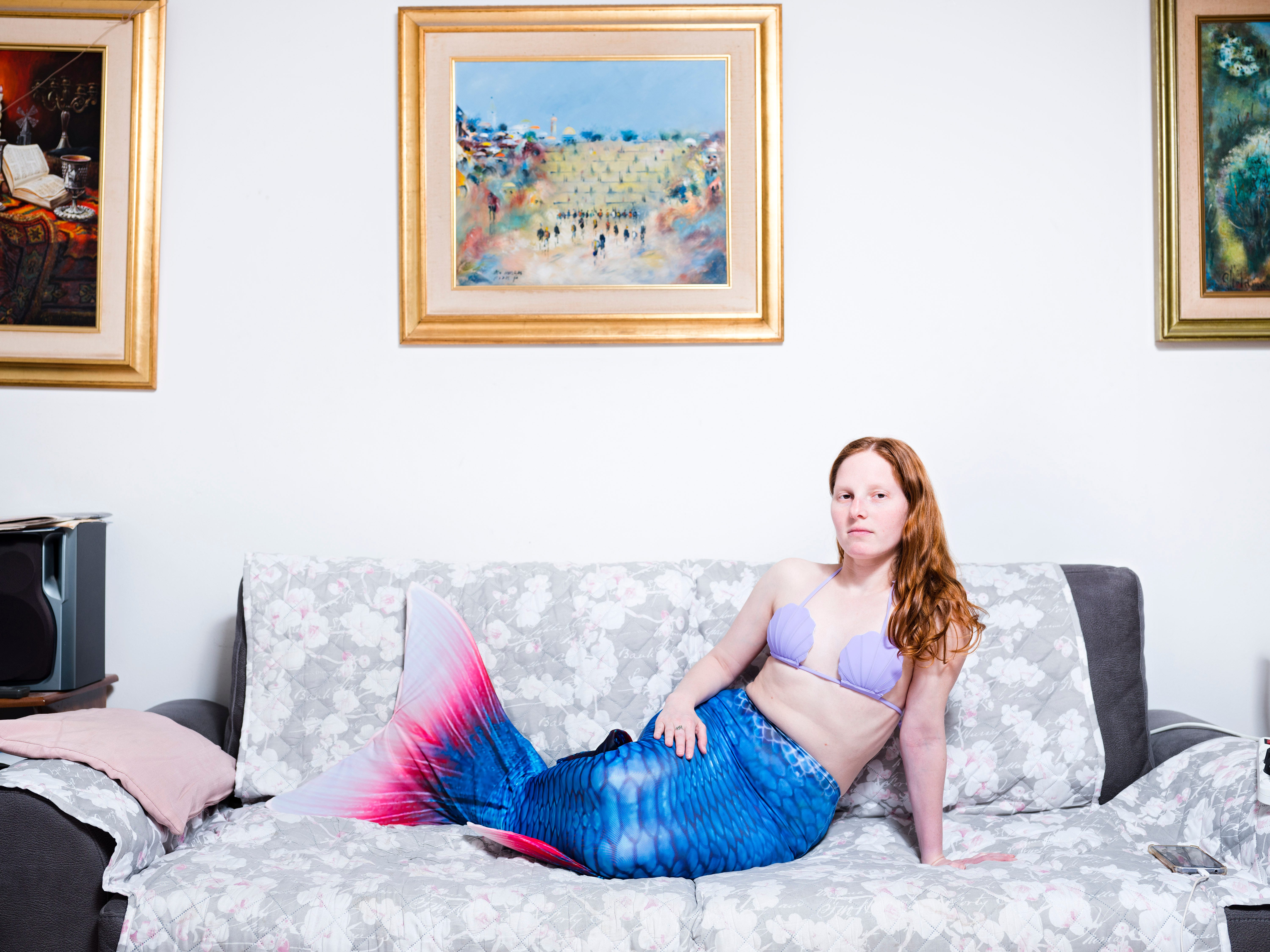 In this Tuesday, March. 26, 2019 photo, Vered Klein, a member of the Israeli Mermaid Community, poses for a portrait as she wears a mermaid tail at her home in Ramat Gan, Israel.