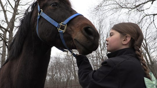 8-year-old Lacey Trezza with her horse