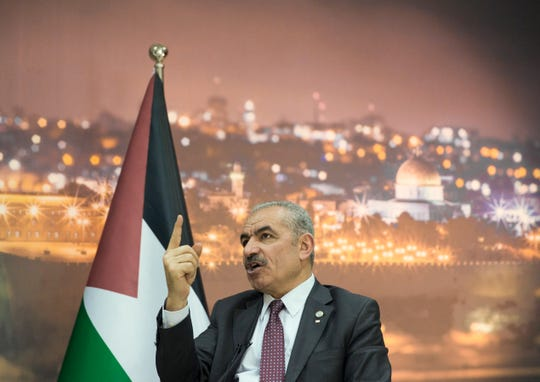 "Palestinian Prime Minister Mohammad Shtayyeh italks during an interview with The Associated Press, at his office in the West Bank city of Ramallah, April 16, 2019. Stayyeh accused the United States of declaring ""financial war"" on his people and said an American peace plan purported to be in the works will be ""born dead."""
