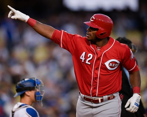 April 15: The Cincinnati Reds' Yasiel Puig reacts while crossing home after hitting a two-run home run during the first inning against the Los Angeles Dodgers at Dodger Stadium.