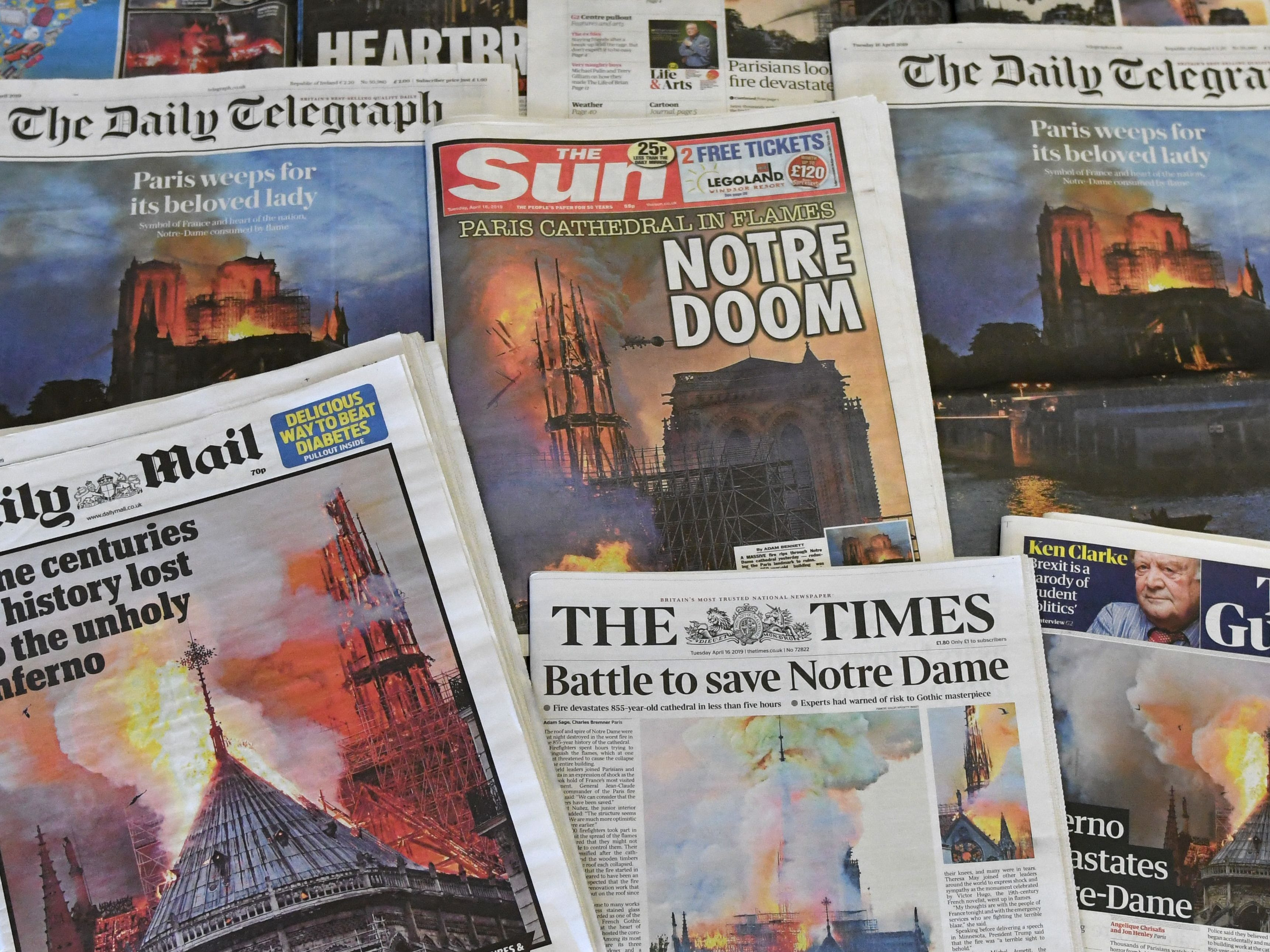Newspaper front pages show the massive blaze that engulfed the Notre-Dame cathedral in Paris on April 16, 2019.