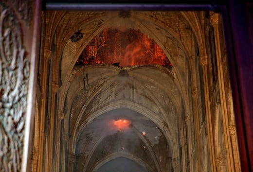 Flames and smoke are seen as the interior of the Notre Dame Cathedralto on April 15, 2019.