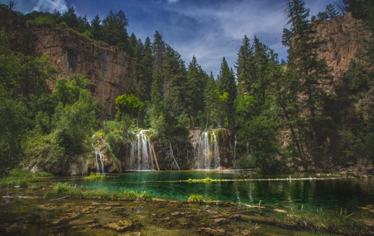 Serene waterfalls and clear green water at Hanging Lake, Glenwood Canyon, Colo.
