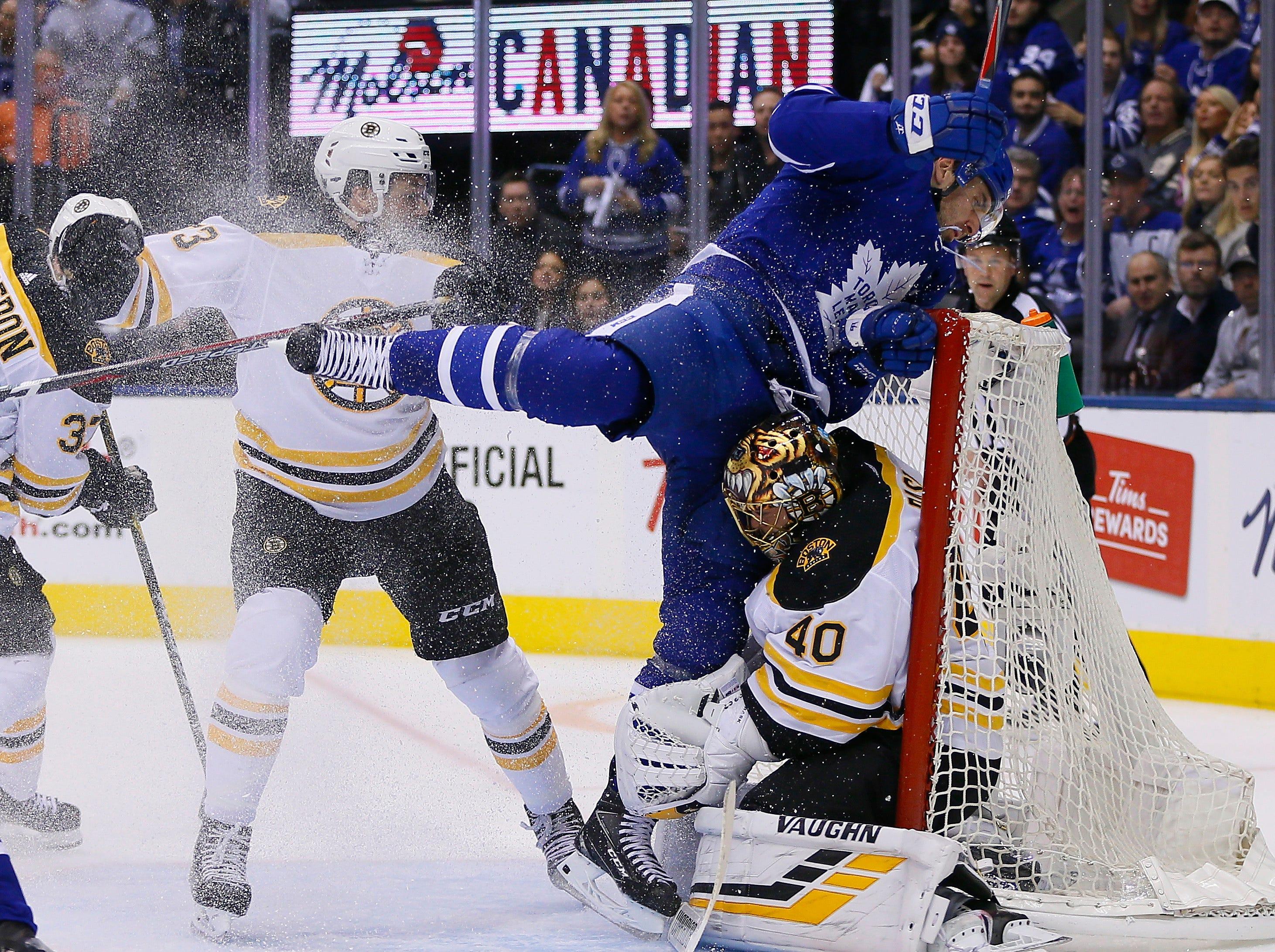 First round: Toronto Maple Leafs forward John Tavares (91) crashes into Boston Bruins goaltender Tuukka Rask (40) during the second period of Game 3.