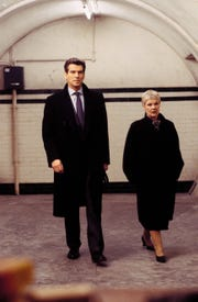 "James Bond (Pierce Brosnan) and M (Judi Dench) at a secret meeting in ""Die Another Day."" (Photo: KEITH HAMSHERE, UNITED ARTISTS)"