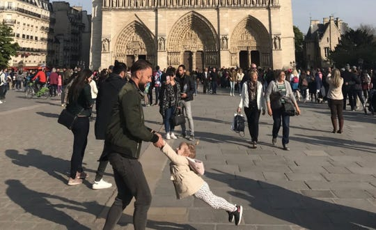 The woman who photographed this image is asking Twitter to help her identify the man and child. She said the image was taken an hour before the Notre Dame Cathedral fire.