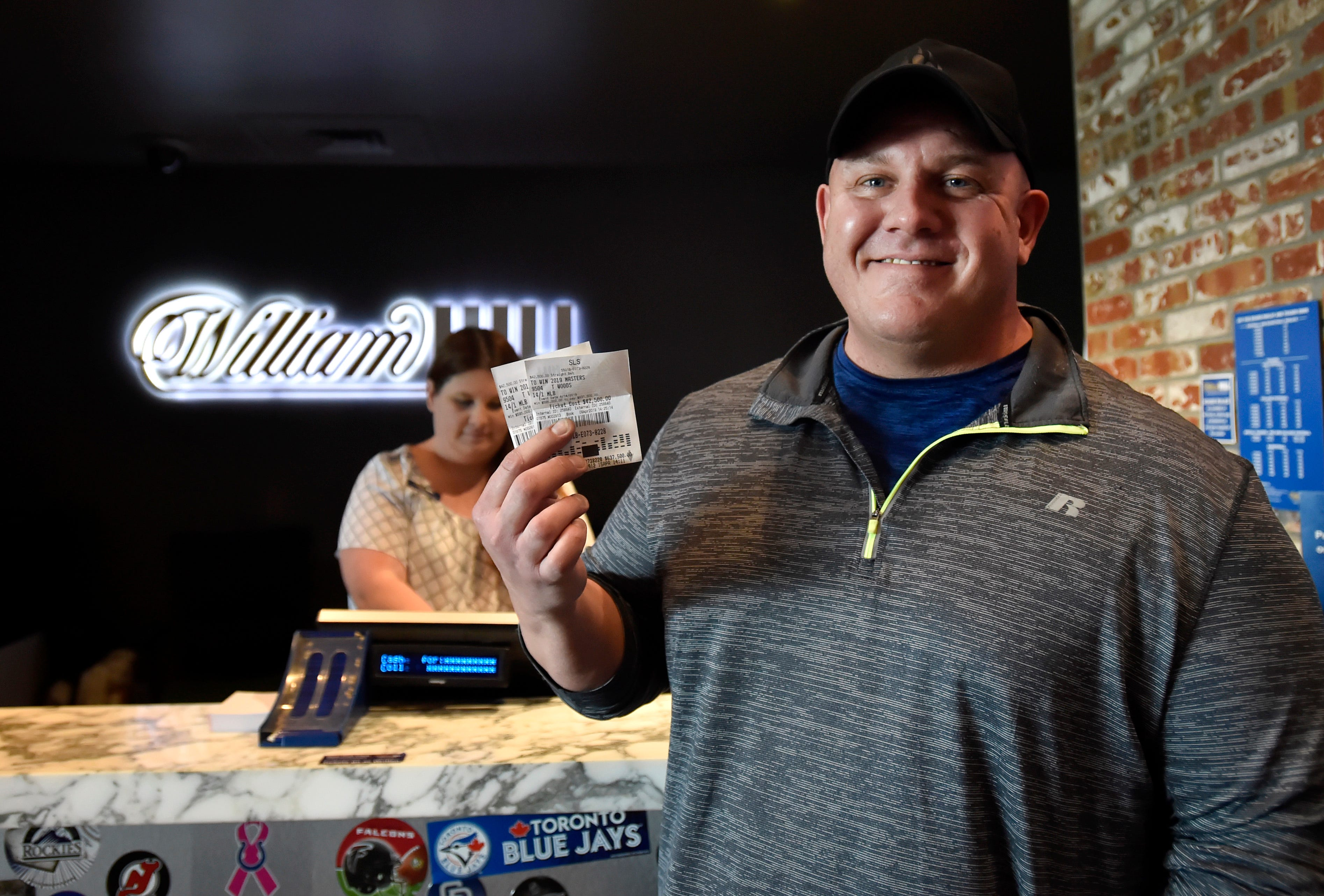 James Adducci holds his winning tickets at the William Hill Sports Book at SLS Las Vegas Hotel on Monday.