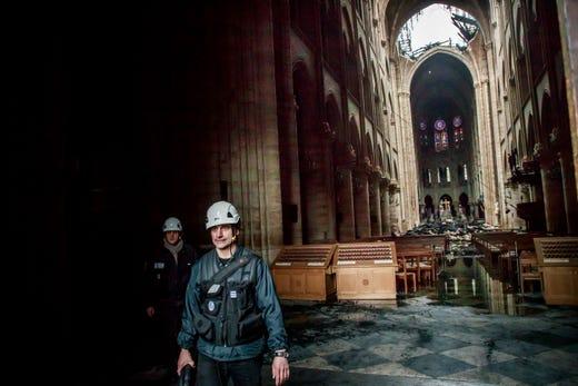 A man walks nside the damaged Notre Dame Cathedral on April 16, 2019.