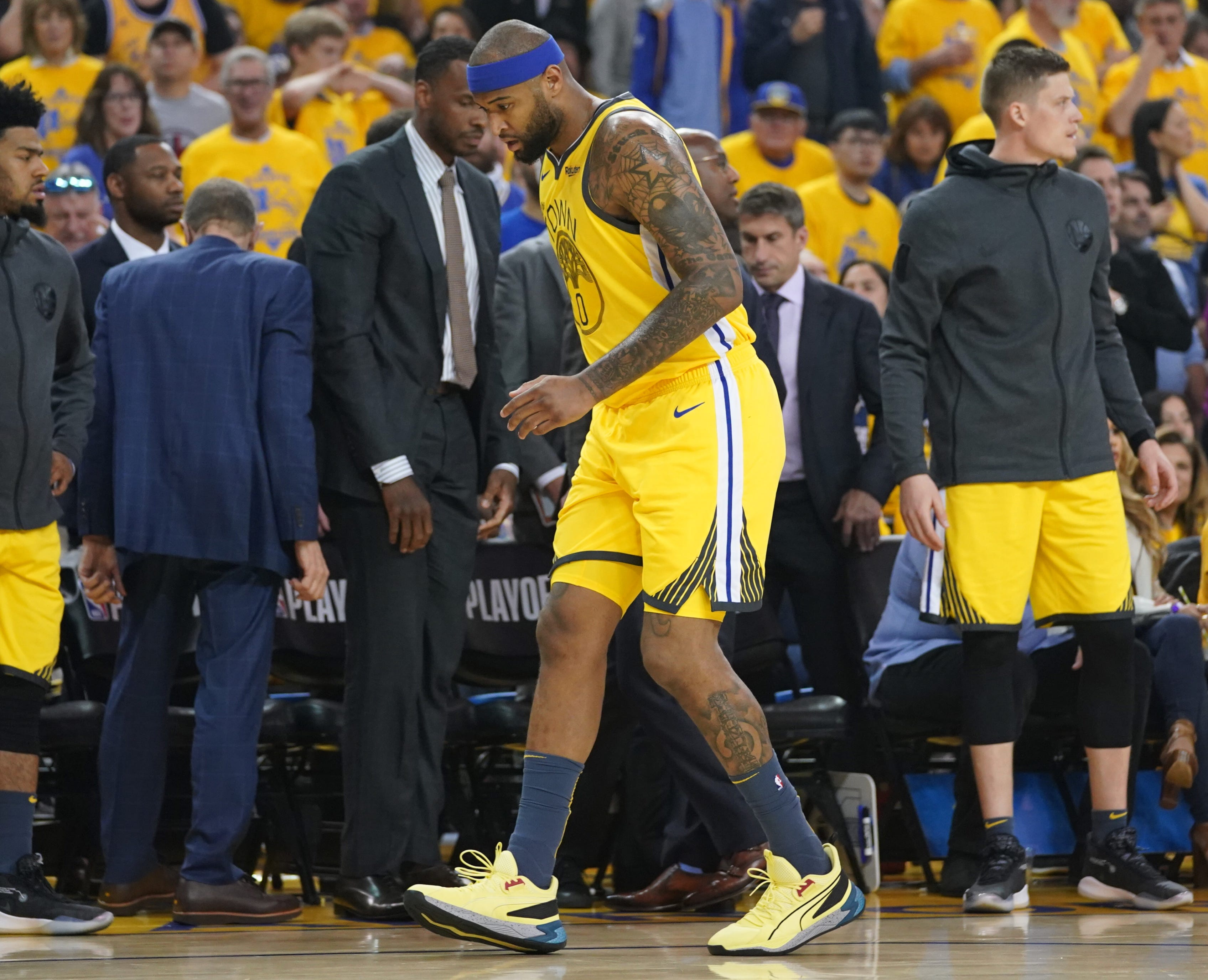April 15: Warriors center DeMarcus Cousins limps off the floor after a quad injury early in Game 2 against the Clippers.