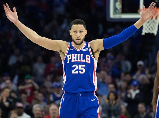 April 15: 76ers guard Ben Simmons tries to pump up the crowd during Game 2 against the Nets.
