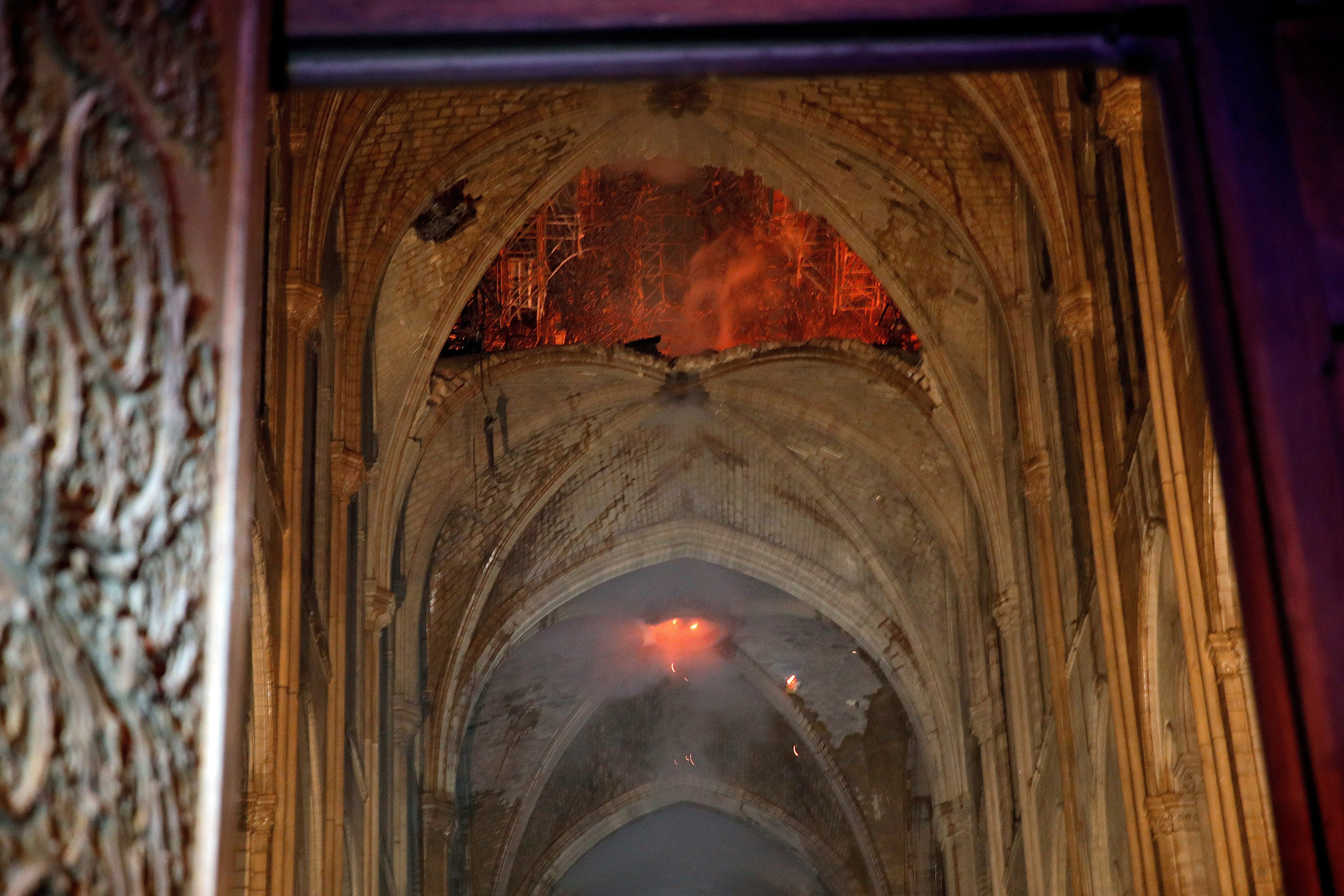 Flames and smoke are seen as the interior at Notre Dame cathedral in Paris, Monday, April 15, 2019. A catastrophic fire engulfed the upper reaches of Paris' soaring Notre Dame Cathedral as it was undergoing renovations Monday, threatening one of the greatest architectural treasures of the Western world as tourists and Parisians looked on aghast from the streets below.