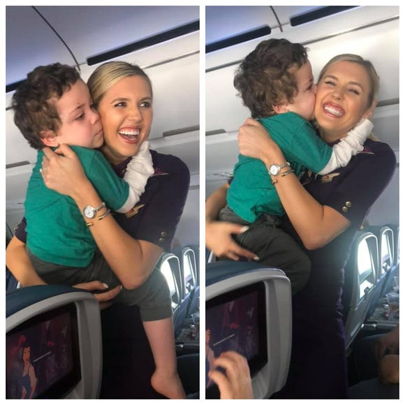 Xayvior Johnson shows his appreciation to Delta flight attendant Amanda Amburgy.