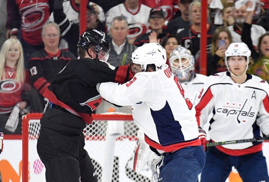 Alex Ovechkin fights Andrei Svechnikov during the first period of Game 3.
