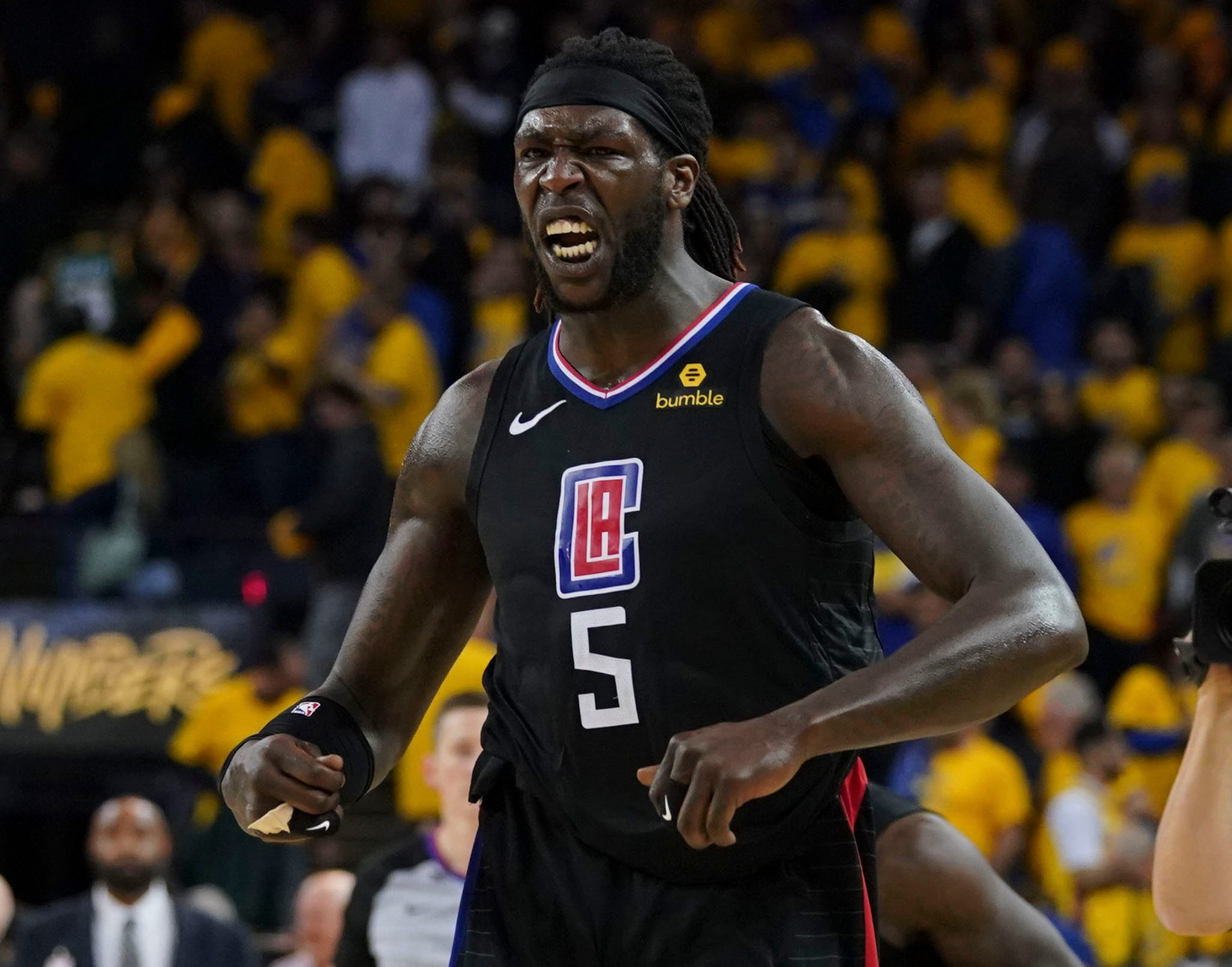 April 15: Montrezl Harrell celebrates after the Clippers stunned the Warriors with the biggest comeback in playoff history to win Game 2 in Oakland.
