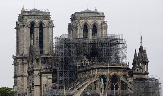 View of the Notre Dame cathedral after the fire in Paris, Tuesday, April 16, 2019. A catastrophic fire engulfed the upper reaches of Paris' soaring Notre Dame Cathedral as it was undergoing renovations Monday, threatening one of the greatest architectural treasures of the Western world as tourists and Parisians looked on aghast from the streets below.
