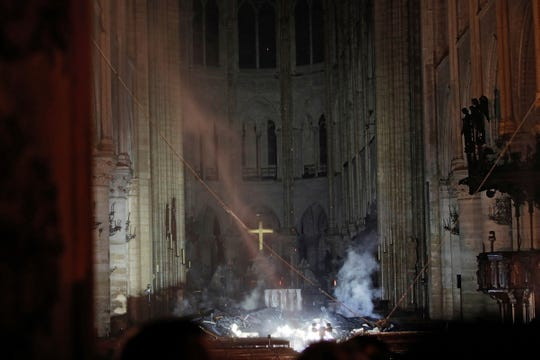 Smoke and debris litter the area around the altar inside Notre Dame Cathedral in Paris. A catastrophic fire Monday engulfed the upper reaches of the cathedral, which was undergoing renovations, and its iconic spire collapsed.