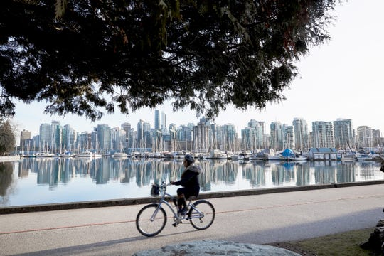 Biking is a favorite way to explore Vancouver's Seawall, and its most famous green space, Stanley Park.