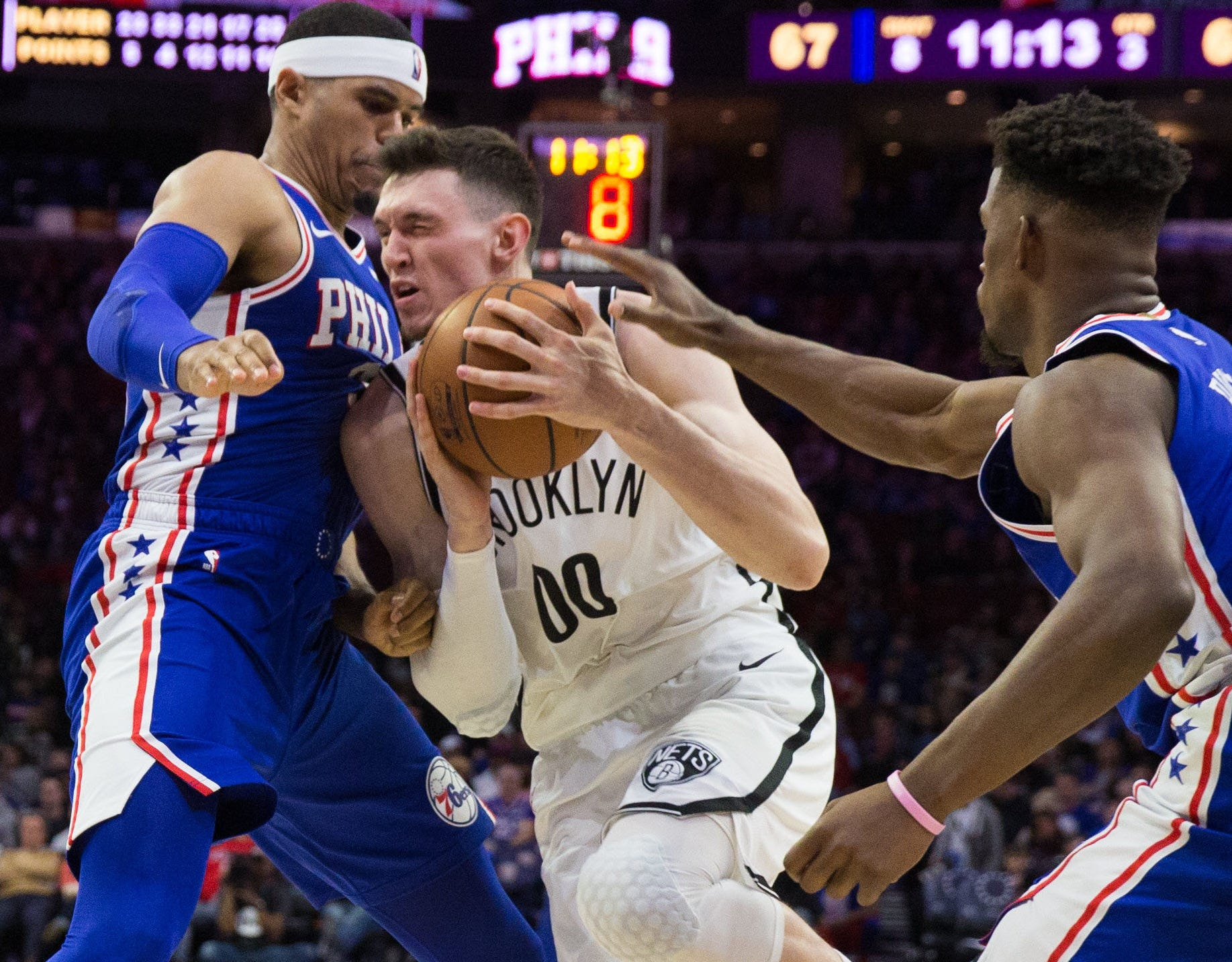 April 15: Nets forward Rodions Kurucs tries to drive between 76ers defenders Tobias Harris and Jimmy Butler during Game 2 in Philadelphia.