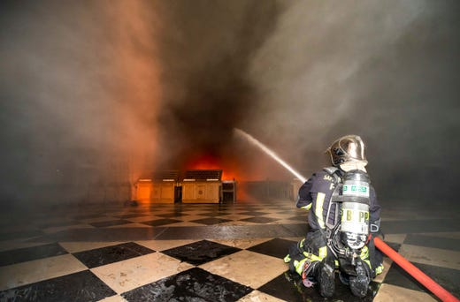 This photo provided by the Paris Fire Brigade shows fire fighters spraying water inside Notre Dame Cathedral on April 15, 2019.