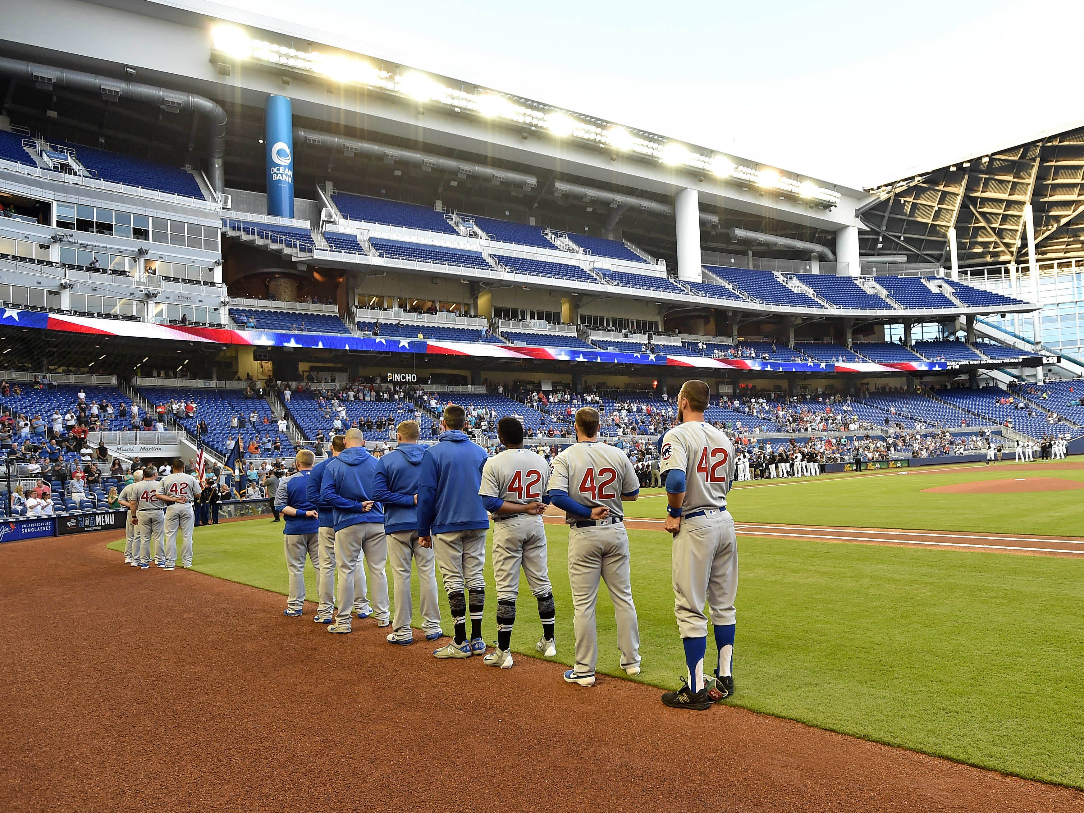 Chicago Cubs players line up during the national anthem wearing the number 42 in honor of Jackie Robinson Day before a game against the Miami Marlins at Marlins Park.