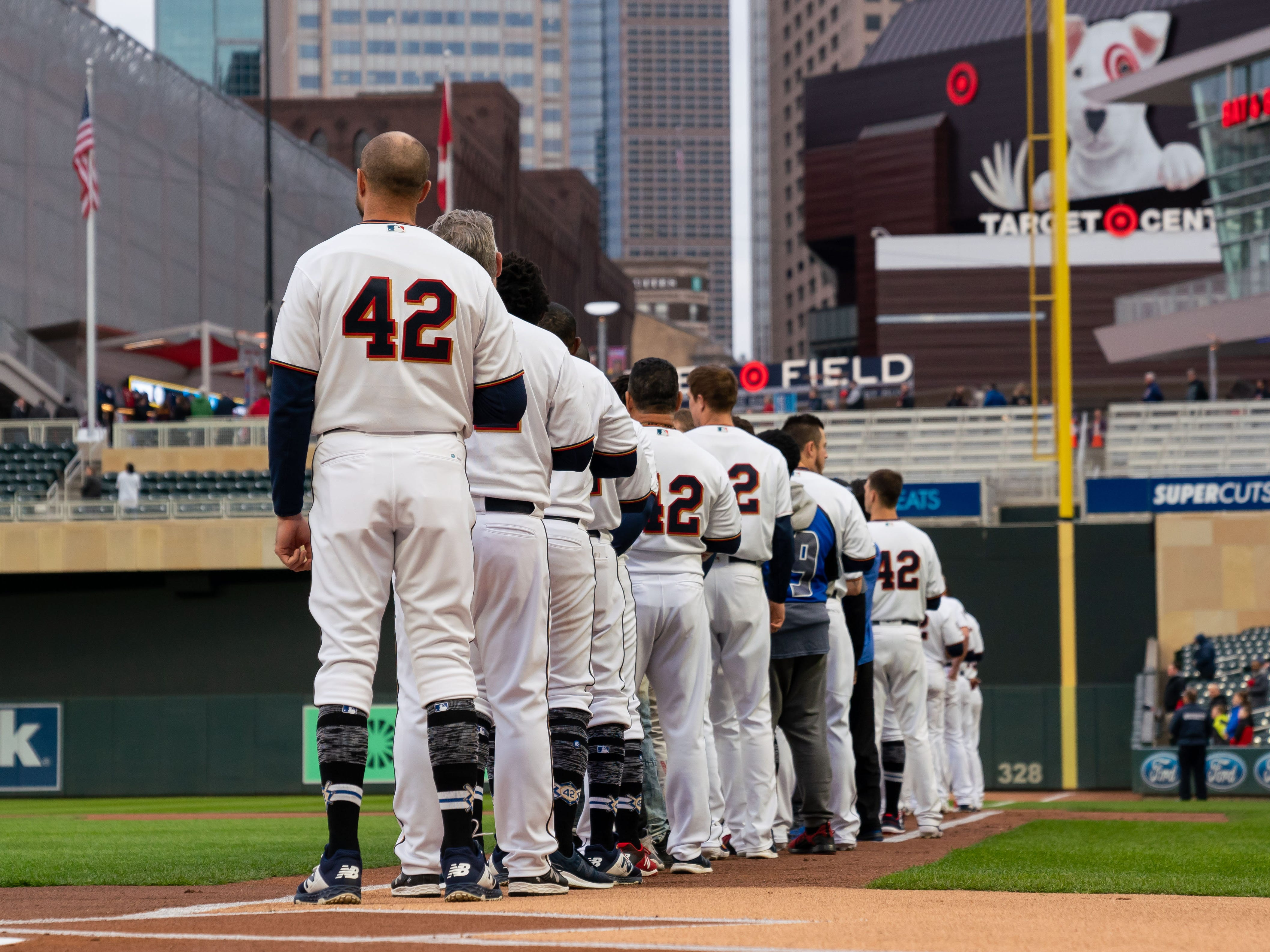 The Twins line up for the national anthem with the No. 42 on their jersey for Jackie Robinson.