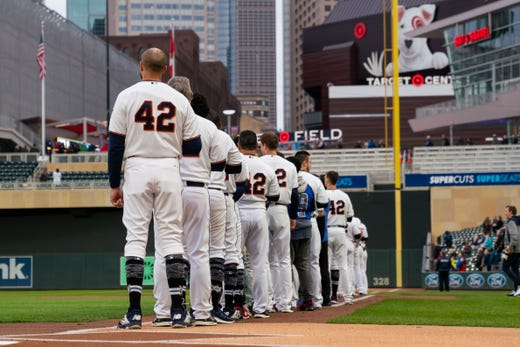 The Twins line up for the national anthem with the No. 42 on their jersey for Jackie Robinson. - Rays Pitcher Breaks Toe In Freak Accident