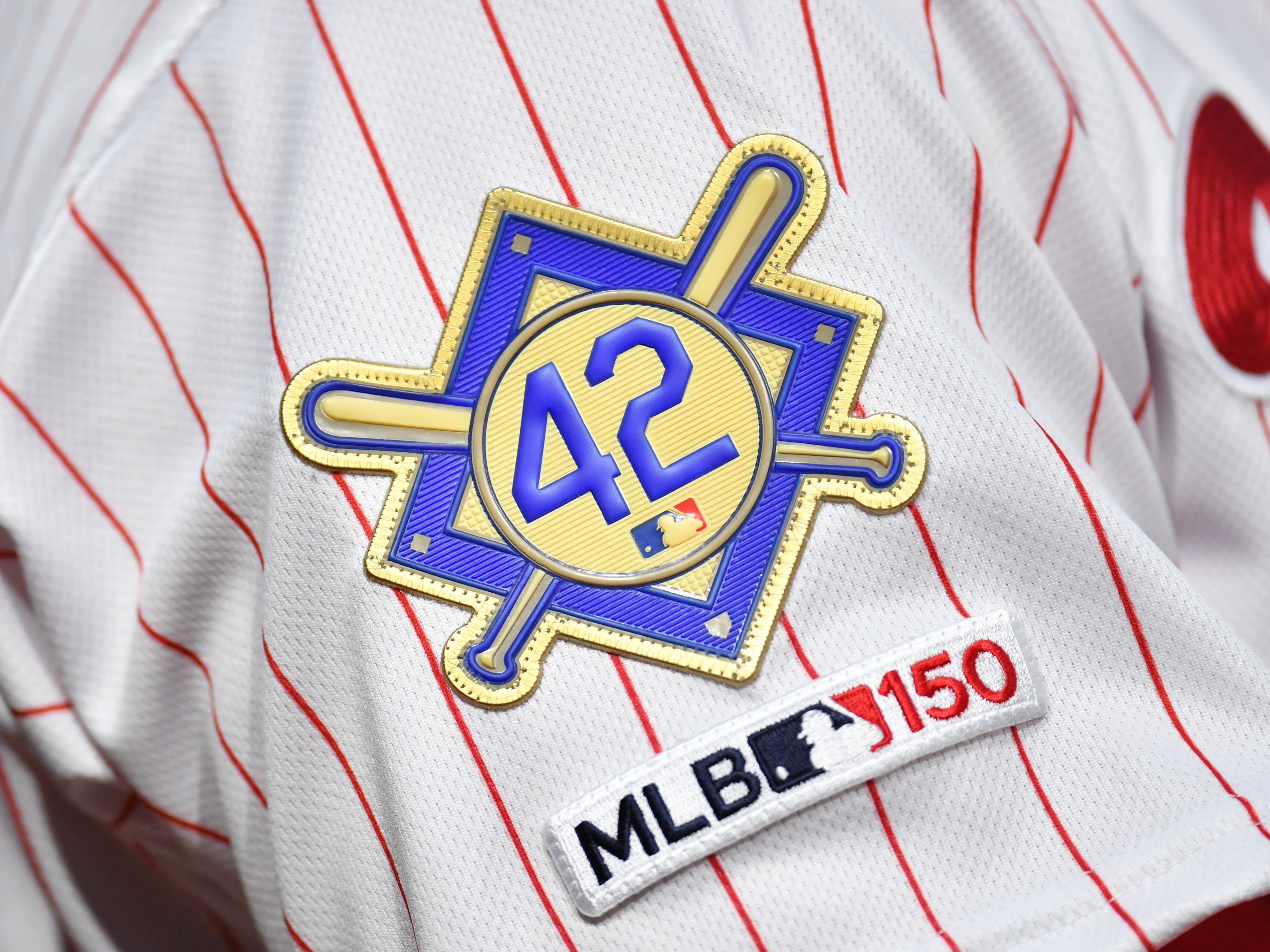 A Jackie Robinson patch is worn on the sleeve of Phillies shortstop Jean Segura.